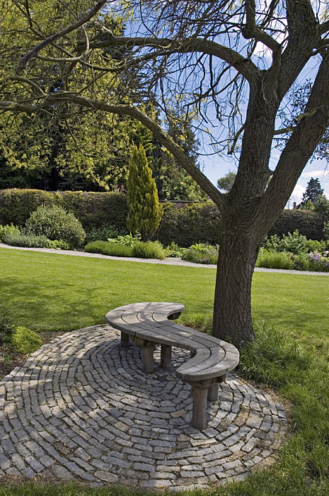 Stepping stones raised beds and woods on pinterest for Benches that go around trees
